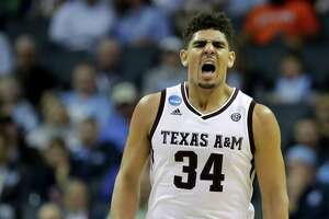 CHARLOTTE, NC - MARCH 16:  Tyler Davis #34 of the Texas A&M Aggies reacts in the second half against the Providence Friars during the first round of the 2018 NCAA Men's Basketball Tournament at Spectrum Center on March 16, 2018 in Charlotte, North Carolina.