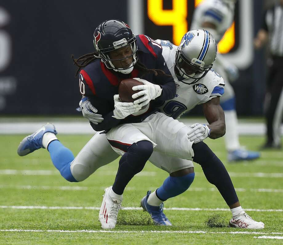 Houston Texans wide receiver DeAndre Hopkins (10) tries to make a catch as Detroit Lions defensive back Johnson Bademosi (29) tackled him a moment later, he lost possession of the ball during the third quarter an NFL football game at NRG Stadium, Sunday,Oct. 30, 2016 in Houston.   ( Karen Warren / Houston Chronicle ) Photo: Karen Warren, Houston Chronicle