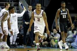 CHARLOTTE, NC - MARCH 16:  TJ Starks #2 of the Texas A&M Aggies reacts after a three point shot against the Providence Friars during the first round of the 2018 NCAA Men's Basketball Tournament at Spectrum Center on March 16, 2018 in Charlotte, North Carolina.