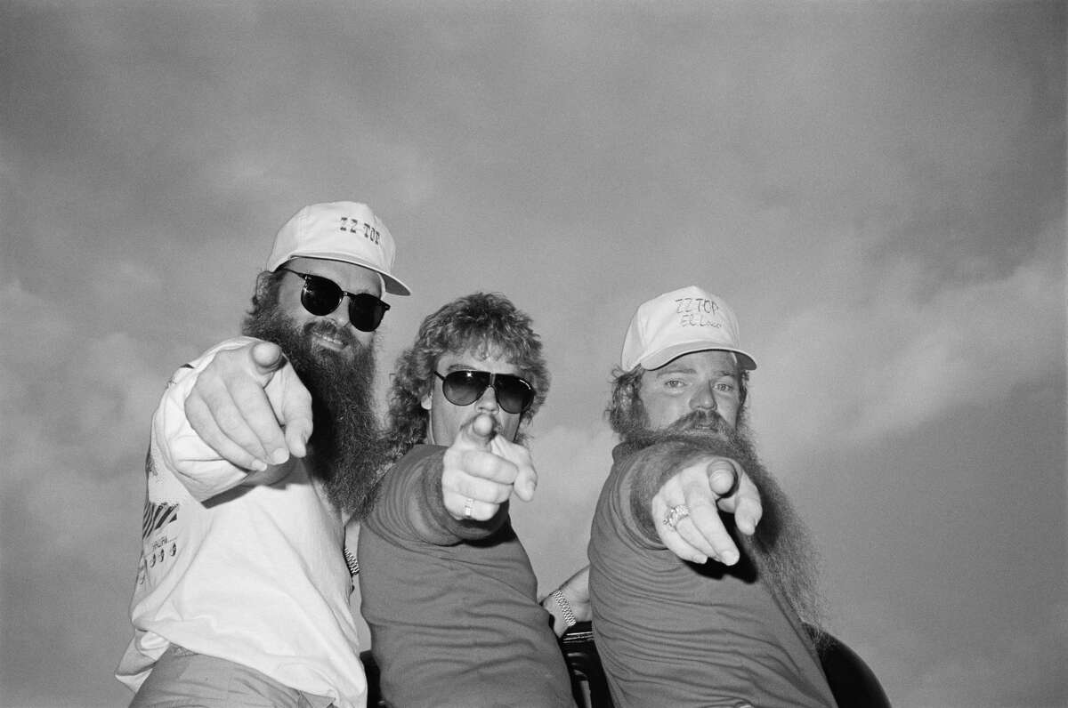 ZZ Top posed backstage at the Donnington Festival, Castle Donnington on 20th August 1983. Left to Right: Billy Gibbons, Frank Beard, Dusty Hill.