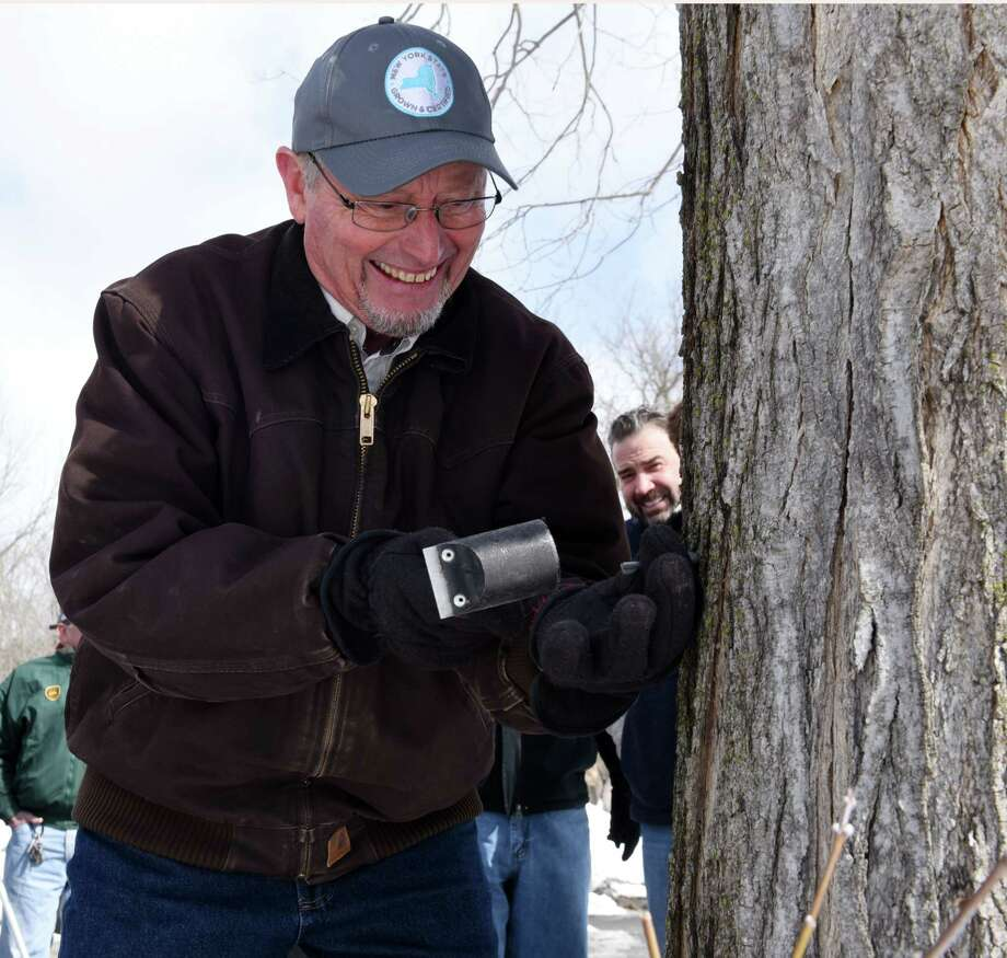 New York State Department of Agriculture and Markets Commissioner Richard Ball taps a maple tree at Riverside Maple Farms to officially launch the 2018 maple season on Friday, March 16, 2018, in Glenville N.Y. (Will Waldron/Times Union) Photo: Will Waldron, Albany Times Union / 20043230A