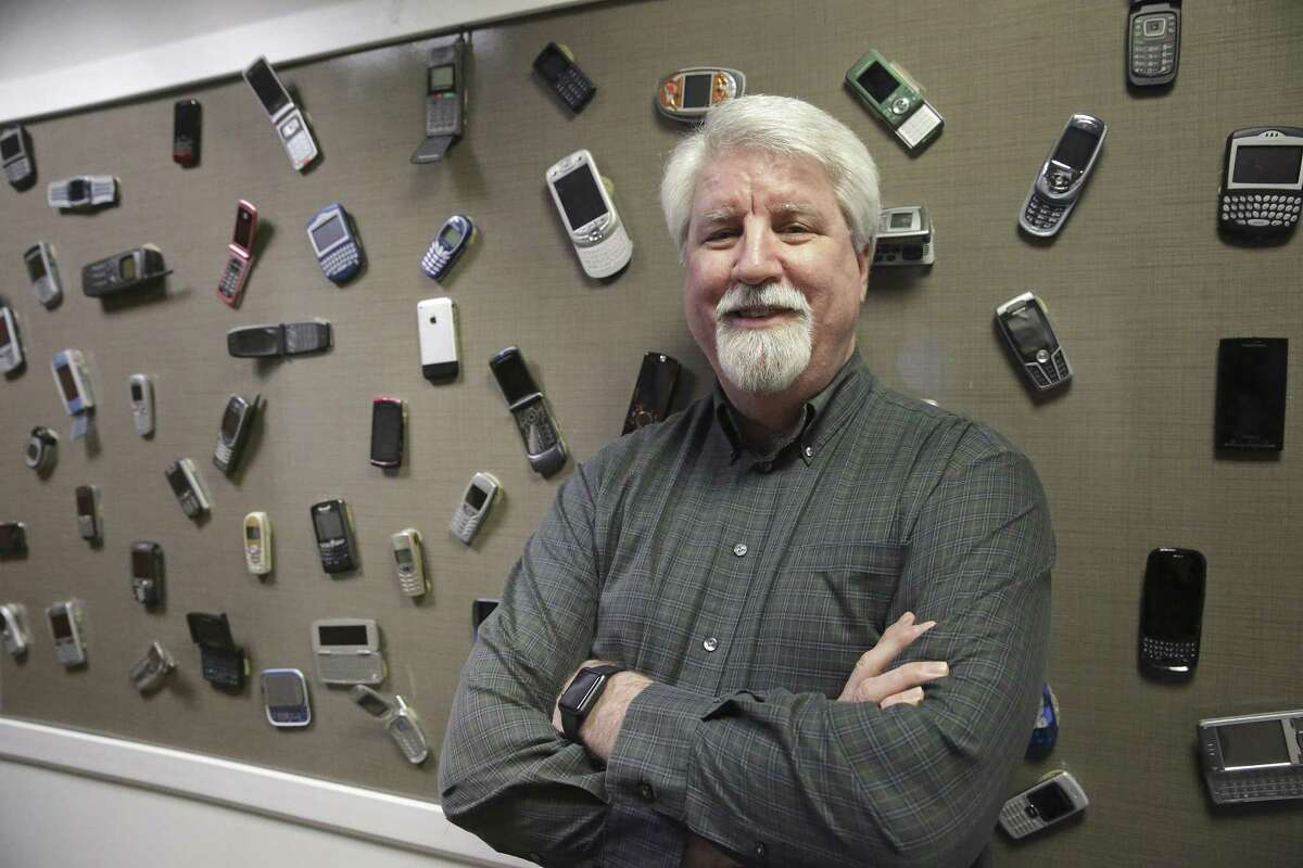 Dave Wolter, assistant vice president of radio technology and strategy at AT&T, in front of a display board of old phones at AT&T's Austin 5G lab on February 16, 2018. Its predecessor, 4G technology, was aimed at mobile phones while 5G technology provides super fast connectivity for larger and more complex devices, including self-driving cars.