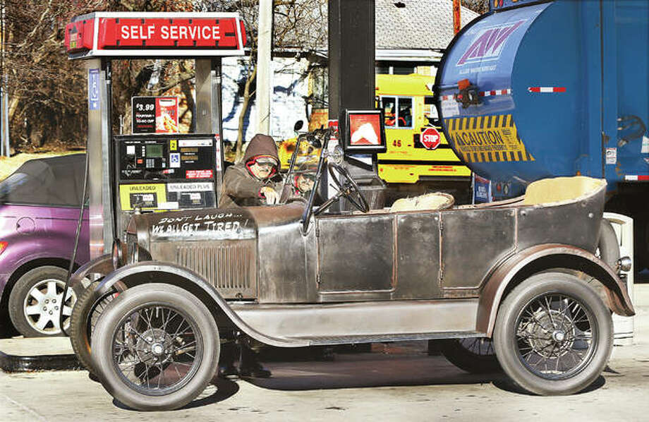 "The owner of a 1926 Ford Model T fills up at the local Casey's on Washington Avenue in Alton. It takes a bit more to fill this ""Tin Lizzie"" than it did when it was new, 92 years ago, when gas was, by all accounts, less than 24 cents per gallon. Photo: John Badman 