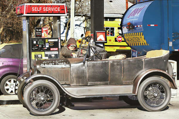 "The owner of a 1926 Ford Model T fills up at the local Casey's on Washington Avenue in Alton. It takes a bit more to fill this ""Tin Lizzie"" than it did when it was new, 92 years ago, when gas was, by all accounts, less than 24 cents per gallon."