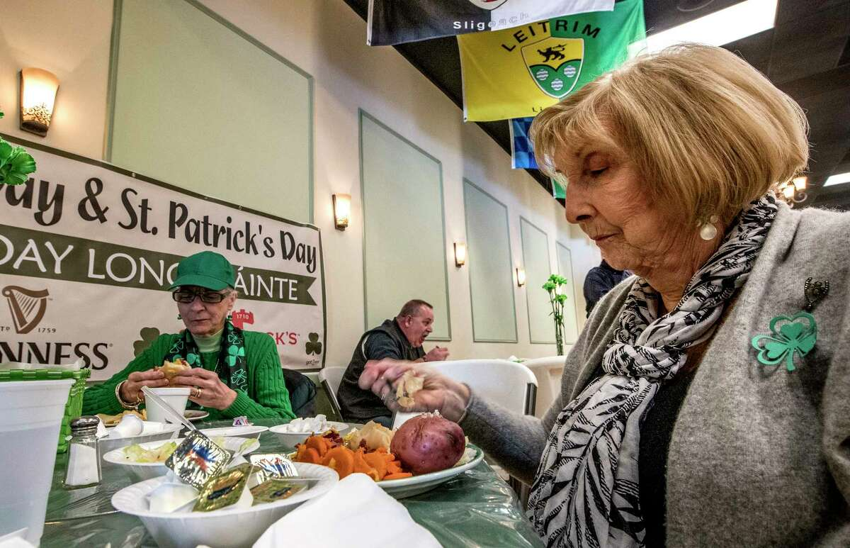 Nancy Walker, left, and Irene Regimbald of Colonie enjoy the corned beef and cabbage dinner at the Ancient Order of Hibernians Hall during a St. Patrick's Day dinner on Friday, March 16, 2018, Albany, N.Y. (Skip Dickstein/Times Union)