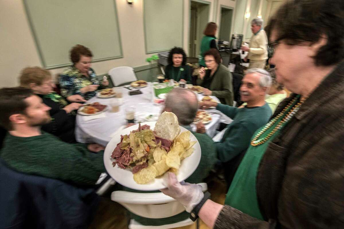 Corned beef and cabbage is the dinner staple of the day at the Ancient Order of Hibernians Hall during a St. Patrick's Day dinner on Friday, March 16, 2018, Albany, N.Y. (Skip Dickstein/Times Union)