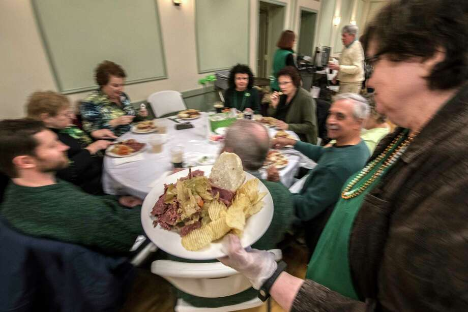 Corned beef and cabbage is the dinner staple of the day at the Ancient        Order of Hibernians Hall during a St. Patrick's Day dinner on Friday,        March 16, 2018, Albany, N.Y. (Skip Dickstein/Times Union) Photo: SKIP DICKSTEIN, Albany Times Union / 20043159A