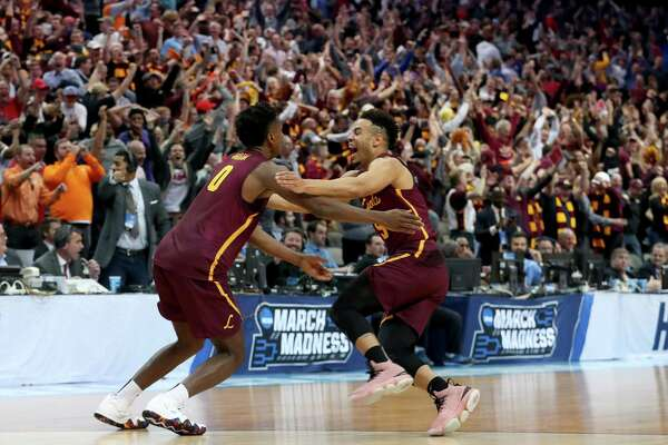 DALLAS, TX - MARCH 15:  Donte Ingram #0 and Marques Townes #5 of the Loyola Ramblers celebrate after Ingram makes a game-winning three pointer against the Miami Hurricanes in the first round of the 2018 NCAA Men's Basketball Tournament at American Airlines Center on March 15, 2018 in Dallas, Texas.  (Photo by Tom Pennington/Getty Images)