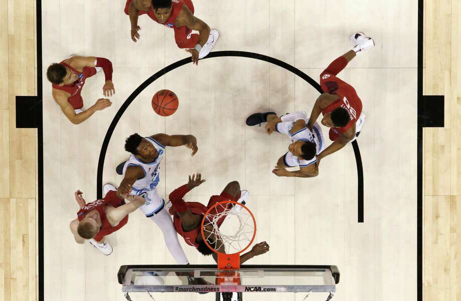 Cyril Langevine #10 of the Rhode Island Rams goes up for a shot between Brady Manek #35 and Khadeem Lattin #3 of the Oklahoma Sooners. Photo: Justin K. Aller / Getty Images / 2018 Getty Images