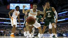 Yves Pons (35) and Lamonte Turner (1) of Tennessee and Everett Winchester of Wright State watch a ball go out of bounds during their first-round game in Dallas Wednesday. Tennessee won 73-47.