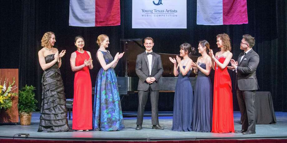Finalists from the 34th annual Young Texas Artists Music Competition pay homage to Grand Prize winner Justin Douté, marimba, center, who also took home the Gold Medal in the Winds, Brass, Percussion, Harp & Guitar division. The event was held March 10 at the Crighton Theatre in downtown Conroe.