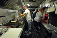 A customer places a food order from Dominic Telesco's food truck, Julian's New York Hot Dogs.