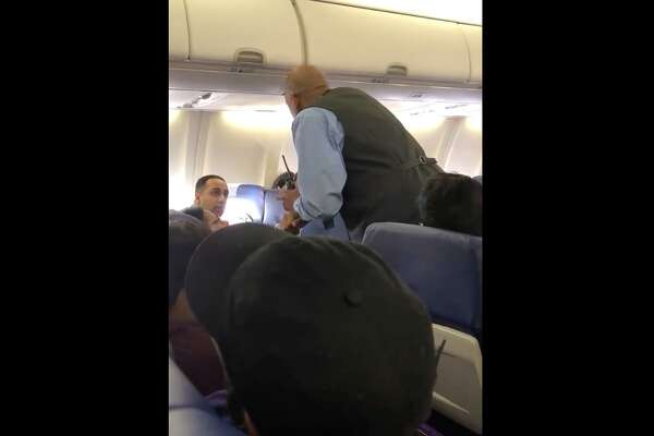 The video begins with a Southwest employee telling the man to leave the flight with his daughter. The man argues that his daughter has calmed down before another airline employee also tells the man to leave the flight.