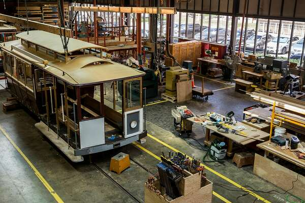 A view from above inside the SFMTA Woods Division Cable Car shop Wednesday, March 14, 2018 in San Francisco, Calif.