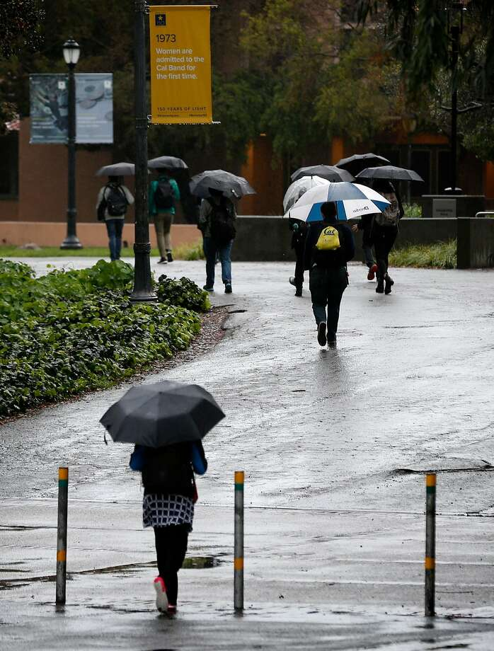 Students walk through the UC Berkeley campus on Friday, March 16, 2018. A series of storms continue to douse the Bay Area. Photo: Paul Chinn / The Chronicle