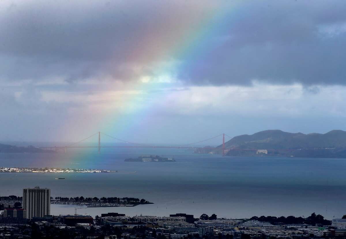 A rainbow tries to take shape over the bay in Oakland, Calif. on Friday, March 16, 2018. A series of storms continue to douse the Bay Area.
