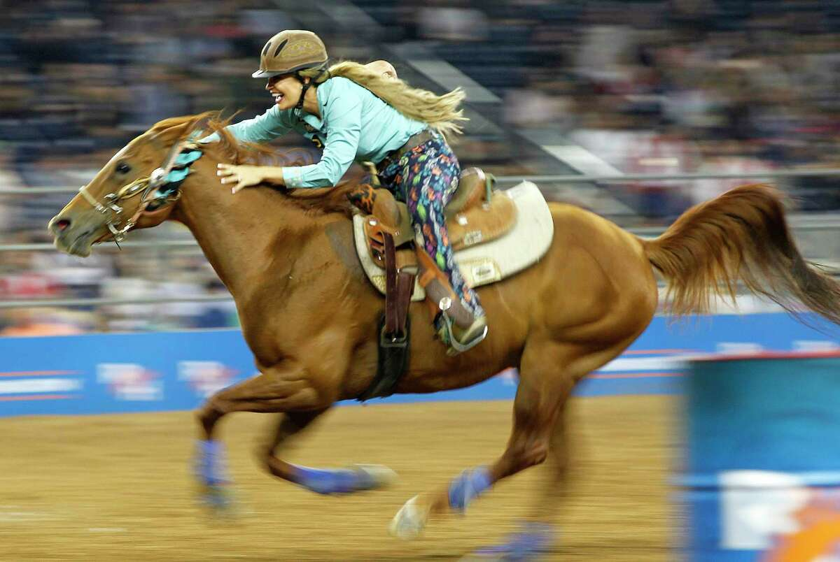 Fallon Taylor is all smiles as she rides to first place in barrel racing during the 2018 Super Series V Round 3 of the Rodeo Houston on Tuesday, March 13, 2018, in Houston.