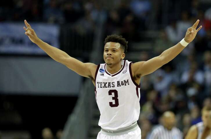 CHARLOTTE, NC - MARCH 16:  Admon Gilder #3 of the Texas A&M Aggies celebrates at the end of their game against the Providence Friars during the first round of the 2018 NCAA Men's Basketball Tournament at Spectrum Center on March 16, 2018 in Charlotte, North Carolina.