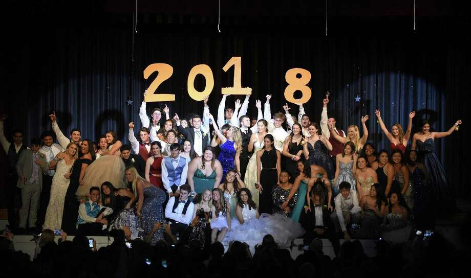"Seniors gather on stage for the show's finale dance after modeling prom fashions during Stamford High School's ""A Starry Knight"" fashion show on Thursday. The event, in its 30th year, raised over $7,000 for the SHS 2018 after-prom party, which will be in the gym at Davenport Elementary School. Photo: Matthew Brown / Hearst Connecticut Media / Stamford Advocate"