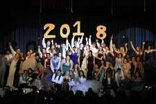 """Seniors gather on stage for the show's finale dance after modeling prom fashions during Stamford High School's """"A Starry Knight"""" fashion show on Thursday. The event, in its 30th year, raised over $7,000 for the SHS 2018 after-prom party, which will be in the gym at Davenport Elementary School."""