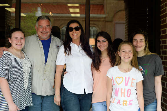 From left: Mary Sanders, Robert Sanders, Carol Barranco Sanders, Brooklyn Broussard, Madison Sanders and Brooke Sanders during the annual St. Joseph's Day lunch at St. Anthony Cathedral Basilica on Friday. The lunch raises money for the Catholic church's charitable efforts, including Some Other Place, the Southeast Texas Food Bank and others.  Photo taken Friday 3/16/18 Ryan Pelham/The Enterprise
