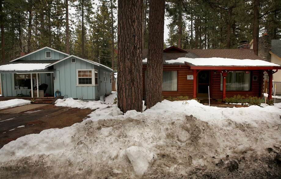 Two homes in the Al Tahoe neighborhood on Sun. March 11, 2018, in South Lake Tahoe, Calif. The home on the left is a residential home while the one on the right is a rental. Until recently, the city's strict Vacation Home Rental Ordinance (VHR) imposed fines of $1,000 for violations. Photo: Michael Macor / The Chronicle 2018