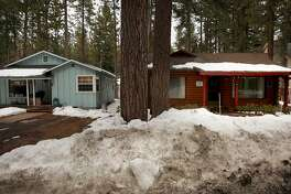 Two homes in the Al Tahoe neighborhood on Sun. March 11, 2018, in South Lake Tahoe, Calif. The home on the left is a residential home while the one on the right is a rental, with the homes so close together in the neighborhood, calls from residents with noise complaints have come from around the neighborhood. The City of South Lake Tahoe has a strict Vacation Home Rental Ordinance (VHR) with fines of $1,000 for violations.