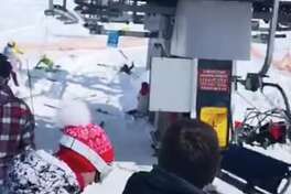 A screenshot taken from a video showing a chairlift at a Georgian ski resort suddenly rolling backwards at twice the normal speed.