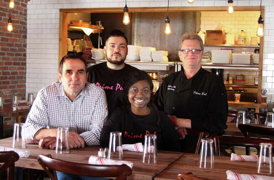 Owner Simi Polozani, left, in his new restaurant, Prime Pub in Danbury, Conn., with employees Istref Dauti, Marjorie Maxi and executive chef Rich Curry, on Friday, March 16, 2018. Photo: Chris Bosak / Hearst Connecticut Media / The News-Times
