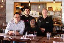 Owner Simi Polozani, left, in his new restaurant, Prime Pub in Danbury, Conn., with employees Istref Dauti, Marjorie Maxi and executive chef Rich Curry, on Friday, March 16, 2018.