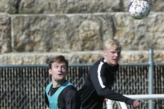San Antonio FC defender Greg Cochrane (left) watches the ball in front of midfielder Connor Presley during training camp.