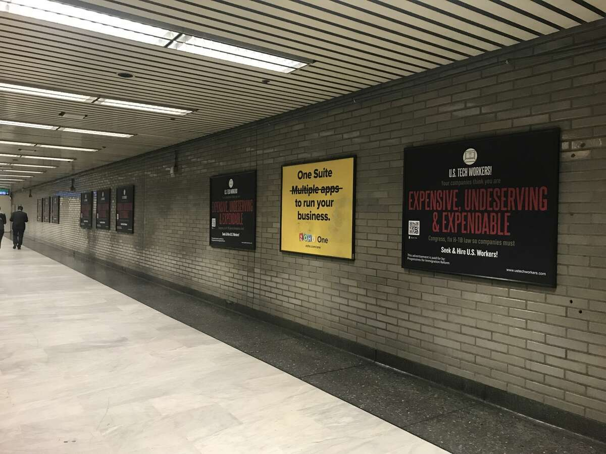 More than a dozen ads were placed inside the Civic Center BART station by Progressives for Immigration Reform. Ten ads (nine of which are pictured here) appear in just one hallway.