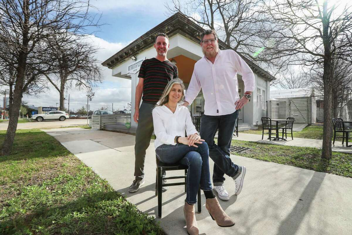Jeffrey Roeske (left-right), Sharon and Chas Haynes pose in front of their business, Retrospect Coffee Bar Monday, Feb. 19, 2018, in Houston. The building was built in 1921 and was an early Gulf Oil gas station. It was abandoned for 40 years and completely dilapidated before this group restored it and turned it into a coffee shop. They have earned a Good Brick Award from Preservation Houston for it. ( Steve Gonzales / Houston Chronicle )