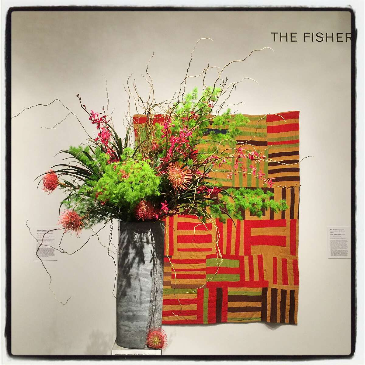 """A Bouquets to Art floral tribute by Kirk Wilder and Acme Floral Co. pays homage to """"Roman Stripes"""" by artist Willie """"Ma Willie"""" Abrams at the de Young Museum on March 12, 2018."""