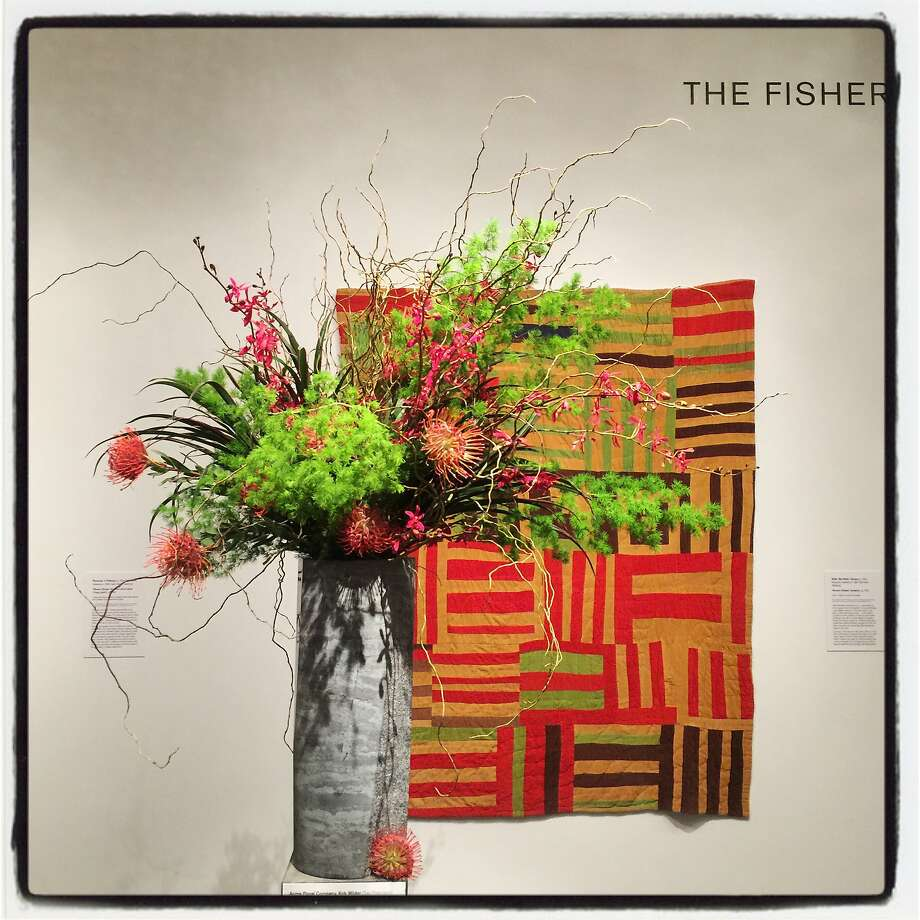 """A Bouquets to Art floral tribute by Kirk Wilder and Acme Floral Co. pays homage to """"Roman Stripes"""" by artist Willie """"Ma Willie"""" Abrams at the de Young Museum on March 12, 2018. Photo: Catherine Bigelow, Special To The Chronicle"""