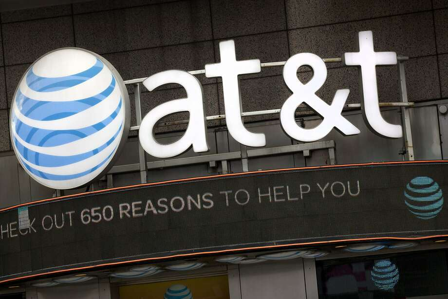 FILE - In this Oct. 24, 2016, file photo, the AT&T logo is positioned above one of its retail stores in New York. AT&T is rising the price of its streaming TV service for the second time this year.  Photo: Mark Lennihan, Associated Press