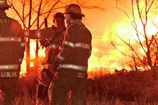 Members of the Midland Fire Department and surrounding volunteer departments work a massive fire at Trinity Pallets, Inc. on S. Highway 349 that started late on the night of Feb. 3, 2018, and continued into the early morning hours of Feb. 4. Pictured in right foreground, Alan Self, of the Greenwood Volunteer Fire Department, was later arrested and charged with arson for multiple fires including the one pictured at Trinity Pallets, Inc. James Durbin/Reporter-Telegram