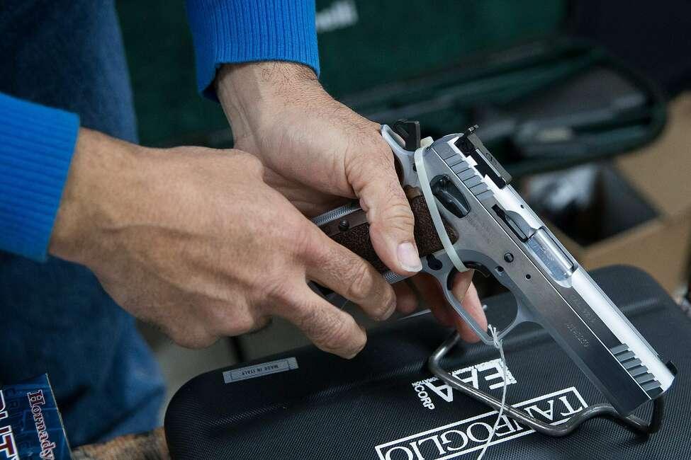 An exhibitor adjusts a handgun during the Sweetwater Rifle and Pistol Club show at Nolan County Coliseum on March 11, 2018 in Sweetwater, Texas.