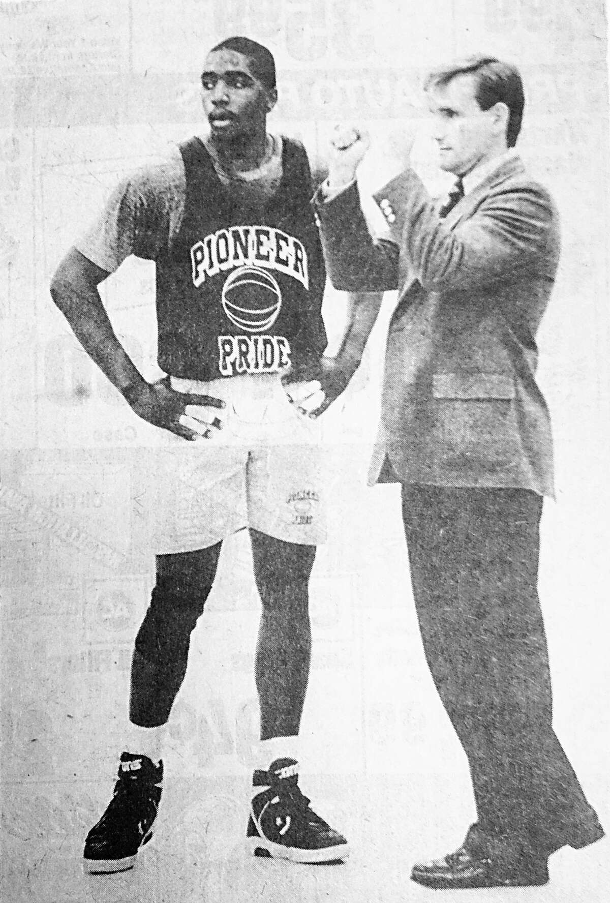 Delta College's Brian Morgan (left) and coach Mike LaRose during a 1989 practice. (Daily News file photo)