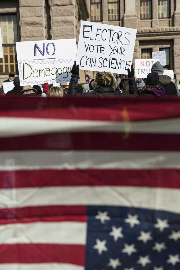 Demonstrators in 2016 outside the Texas Capitol attempt to influence Republican electors to not vote for Donald Trump when they cast their formal ballots for president of the United States. This is what happens in the winner-take-all system. Photo: Tamir Kalifa /Associated Press / FR170773 AP