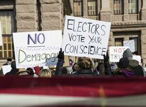 Demonstrators gather outside the Texas State Capitol in an attempt to influence the Republican electors from across the state to not vote for Donald Trump when they cast their formal ballots for president of the United States in Austin Dec. 19, 2016. Leading Democrats are leading the charge to abolish the Electoral College.