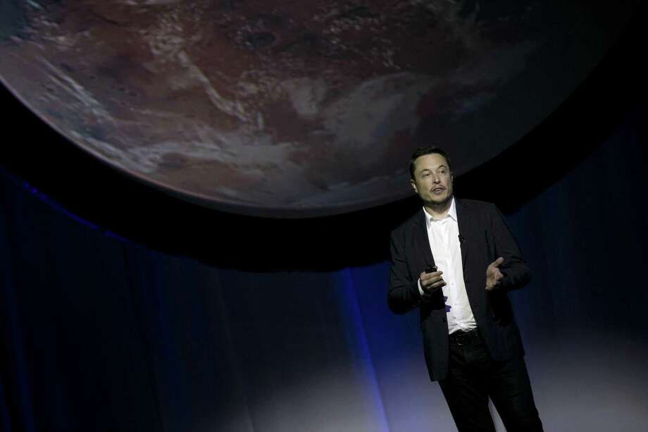 SpaceX founder Elon Musk speaks during the 67th International Astronautical Congress in Guadalajara, Mexico in 2016. In a receptive audience full of space buffs, Musk said he envisions 1,000 passenger ships flying en masse to Mars, 'Battlestar Galactica' style. Photo: Refugio Ruiz /Associated Press / XaLixCo,mEXiCo,2015