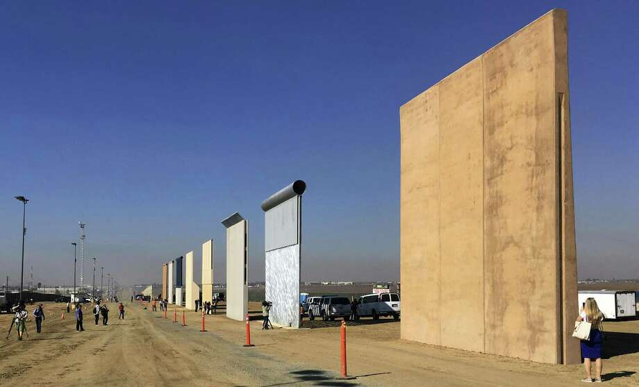 Prototypes of border walls in San Diego in 2017. President Donald Trump was scheduled to check out prototypes in California this week. Photo: Elliott Spagat /Associated Press / Copyright 2018 The Associated Press. All rights reserved.