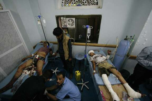 Yemeni medics treat men who were injured during a crossfire between tribal fighters and Shiite rebels known as Houthis in Taiz, Yemen in 2015. U.S. support for Saudi Arabia helps make this carnage possible.