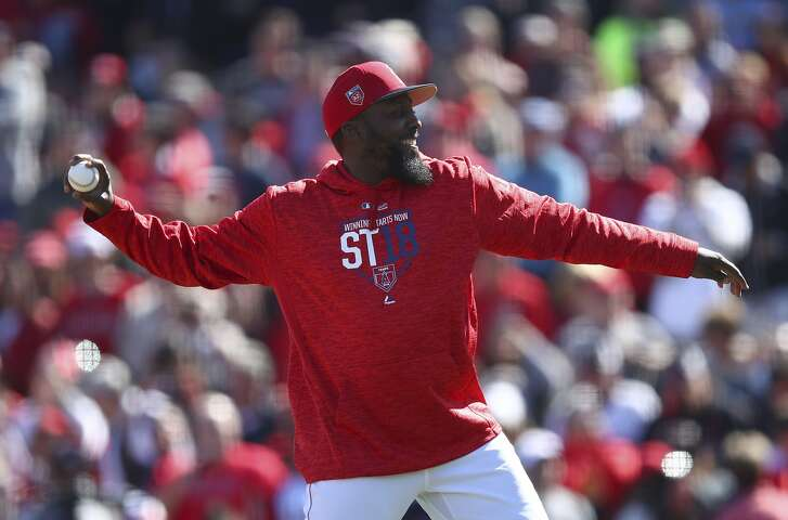 Former Los Angeles Angel Vladimir Guerrero throws out the ceremonial first pitch prior to the spring training baseball game against the Milwaukee Brewers on Saturday, Feb. 24, 2018, in Tempe, Ariz. (AP Photo/Ben Margot)