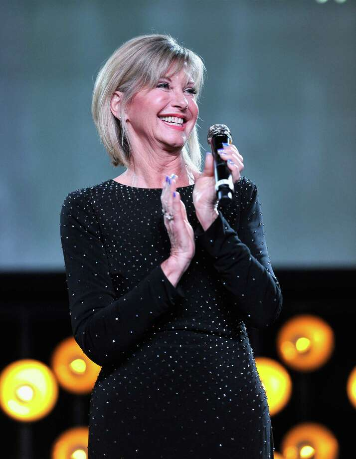 "Olivia Newton-John played Sandy opposite John Travolta's Danny in the 1978 hit ""Grease,"" one of the biggest movie musicals of all time. The soundtrack featured such hits as ""You're the One That I Want,"" ""Hopelessly Devoted to You"" and ""Summer Nights."" She followed up with the smash 1981 dance hit ""Physical."" Taken together, the blockbuster movie and aeorbicized pop hit represented a career makeover for Newton-John, who first came to fame in the mid-'70s with a string of easy-listening hits such as ""I Honestly Love You"" and ""Have You Never Been Mellow."" She recently scored a dance club hit, ""You Have To Believe,"" with her daughter Chloe Lattanzi.8  p.m. Friday. Majestic Theatre, 224 E. Houston St. $45-$99.50. majesticempire.com-- Jim Kiest Photo: (Photo By John Sciulli/Getty Images For G'Day USA), Getty Images For G'Day USA / 2018 Getty Images"