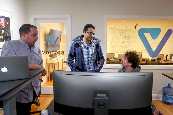 David Wiener, left, chief product officer, Mohamed El-Geish, center, senior director of engineering and Matt Ceravolo, right, senior software engineer have a conversation at the Voicera offices in Menlo Park, Calif., on Thursday, Mar. 15, 2018. Voicera is the creator of Eva, a voice-activated A.I. platform that improves in-meeting and post-meeting experiences using Eva to listen in, take notes & identify key actions.