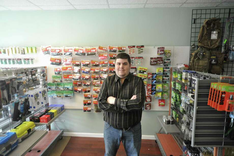 David Ragozzine recently moved his online fishing and outdoor gear store to a space on Main Street in Winsted. Photo: Ben Lambert / Hearst Connecticut Media /