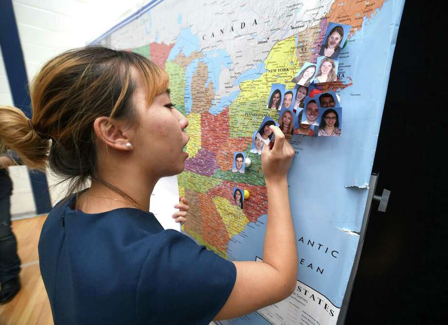 Sumin Park pins her photo on a map showing where medical students  from the Frank H. Netter MD School of Medicine have been accepted for residencies during Match Day at Quinnipiac University in Hamden on March 16, 2018.  Park will be a resident at the Lankenau Medical Center in Pennsylvania. Photo: Arnold Gold / Hearst Connecticut Media / New Haven Register