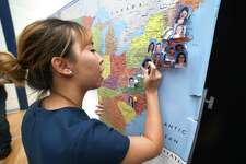 Sumin Park pins her photo on a map showing where medical students  from the Frank H. Netter MD School of Medicine have been accepted for residencies during Match Day at Quinnipiac University in Hamden on March 16, 2018.  Park will be a resident at the Lankenau Medical Center in Pennsylvania.